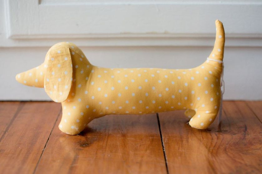 A yellow and white spotted toy dachshund.